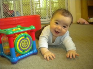 Happy infant crawling